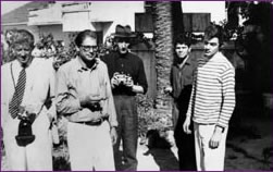 From left to right, Paul Bowles, Allen Ginsberg, William Burroughs, and others, early 1950's